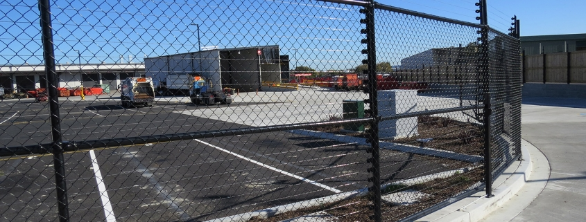 Image showing a Fencerite chainlink fence bordering an industrial carpark with building in the background