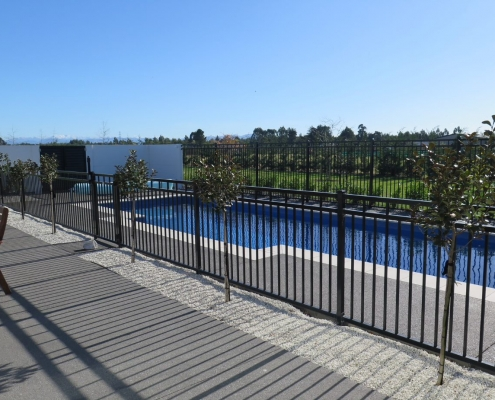 Image showing a beautiful residential swimming pool surrounded by pool fencing