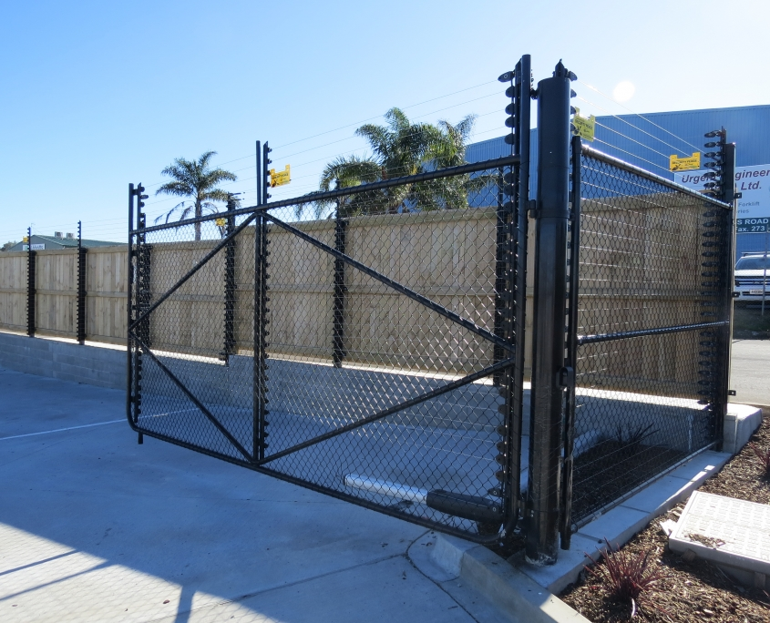 Image showing an automated gate on a commercial premises, installed by Fencerite