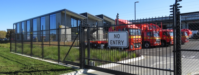 Image showing an entrance to Waste Management, including an automated gate, installed by Fencerite
