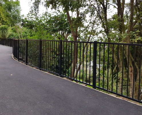 Image showing a public walkway with black balustrades at the side of the walkway and bush area, installed by Fencerite
