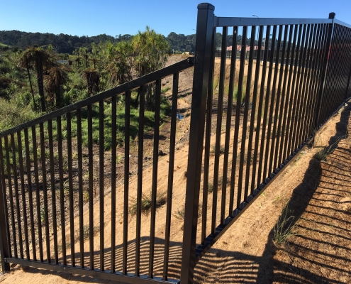Image showing black balustrades surrounding the top of a gully, installed by Fencerite