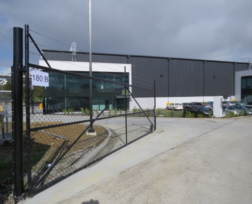 Image showing the entrance to a commercial building, with swing gate, installed by Fencerite