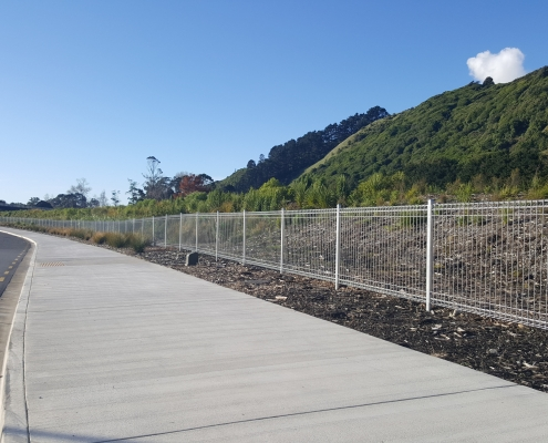 Image showing a long stretch of footpath with bordering welded wire security fencing, installed by Fencerite