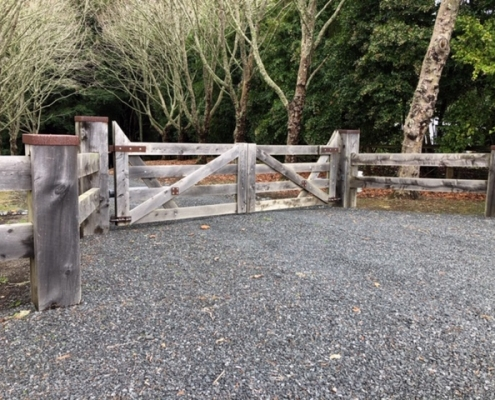 Image showing a wooden gate, at the entrance of a rural property, installed by Fencerite