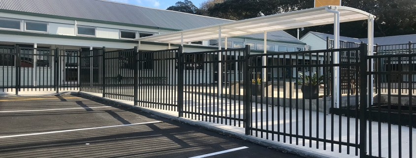 image of an aluminium fence around a school