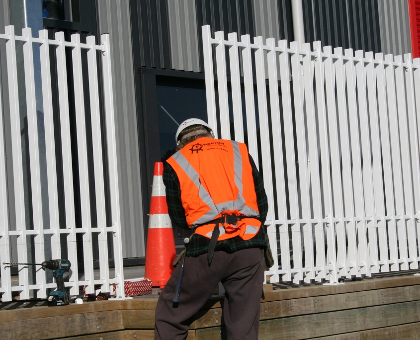 image of a man installing a security fence