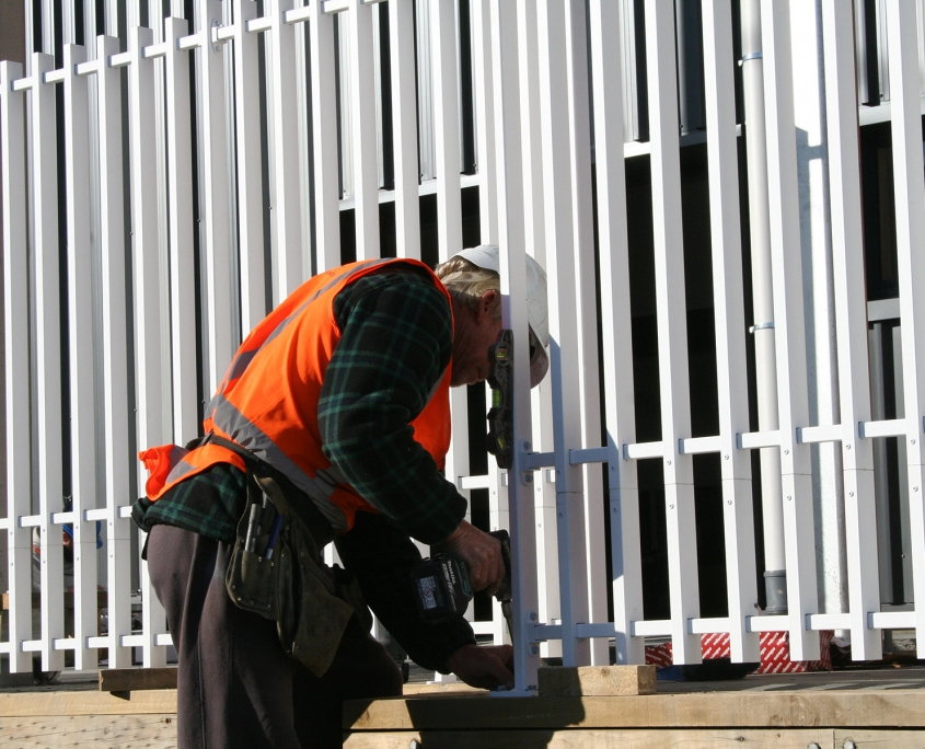 image of a man installing a fence